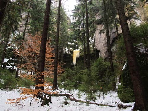 Beautiful orange-colored icicle in the Kirnitzschtal valley