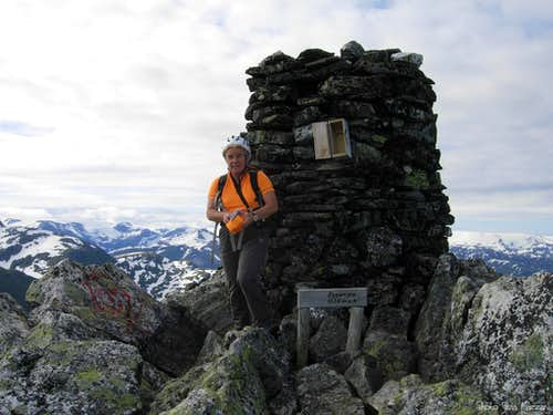 A huge cairn with a wooden summit-box on Eggjenibba