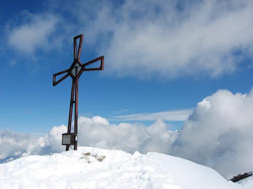 An iron cross on Schneebiger Noch - Vedrette di Ries