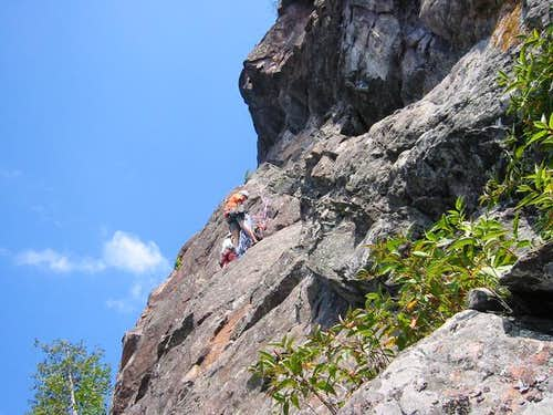 A climber working his way up...