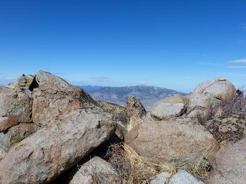 Looking through the summit rocks towards Adams Peak 8,197'