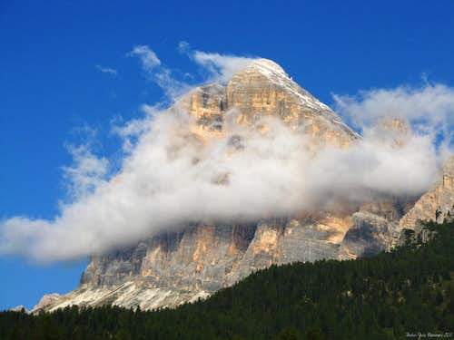 A light cloud wraps Tofana di Rozes South face