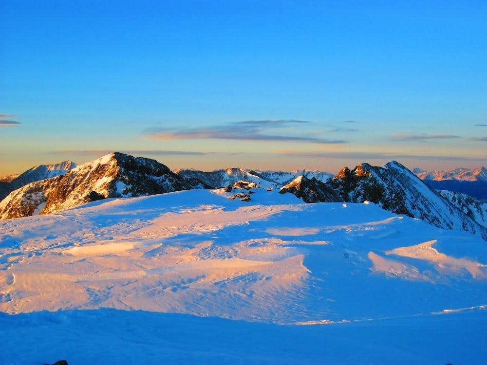 Atlantic Peak's summit cairn framed by Fletcher (L) and Drift (R)