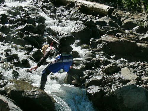 Michael Crossing a Creek