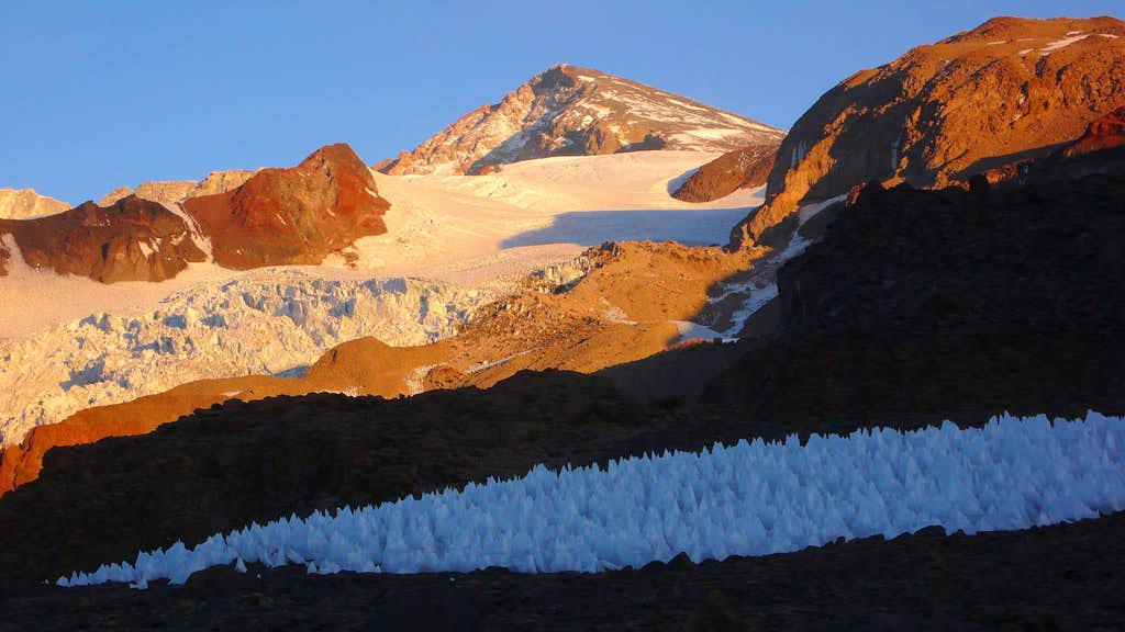Glowing summit pyramid of Marmolejo above the penitentes near camp 1