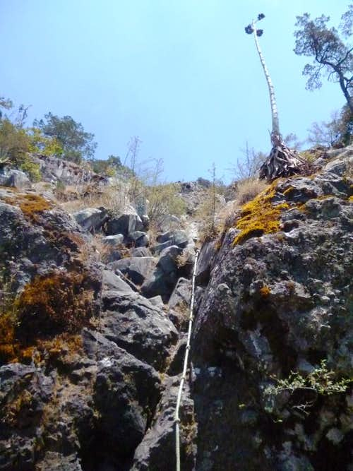 Rope attached to the rocks at the start of the climb up to the summit.