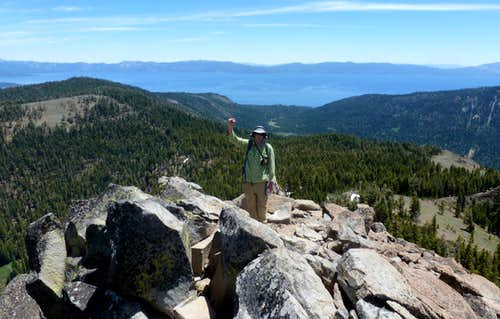 Jordan celebrating reaching the summit Twin Peaks.  Lake Tahoe behind