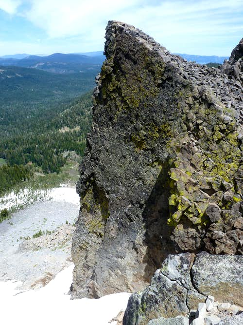 Looking down past the sharp rock at the saddle between the Twin Peaks