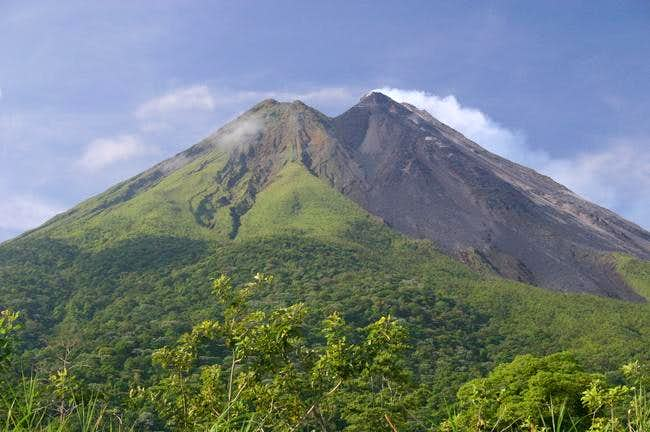 Smoking Arenal volcano from the southeast