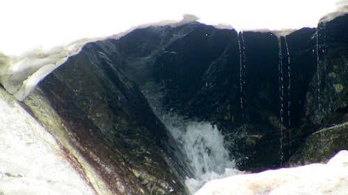 Water under ravine snow