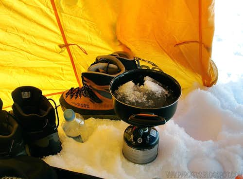Melting snow to cook on Cotopaxi.