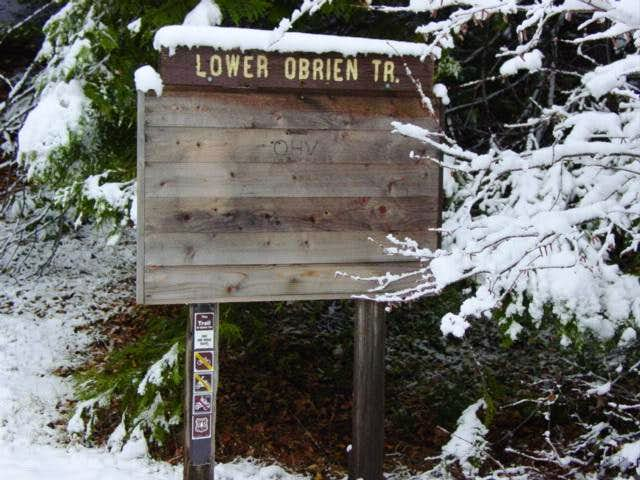 Lower trailhead sign. It's...