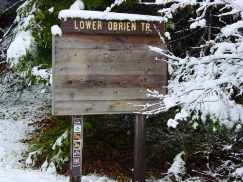 Lower trailhead sign. It\'s...
