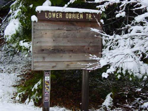 Lower trailhead sign. It's...