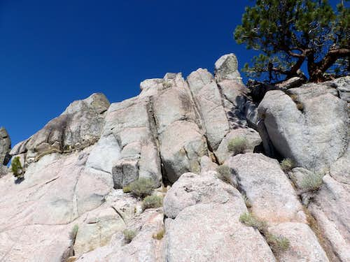 View up the rock towers that make up the summit of Peak 8205