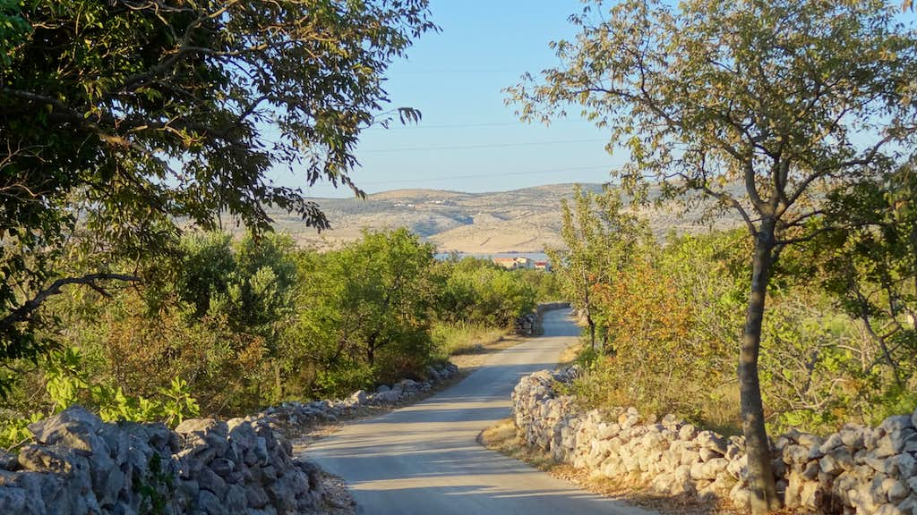 The road leading to Mala Paklenica in early sunrise, looking down to the sea. A mediterranean dream.