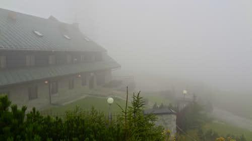 Mountain hut in the mist