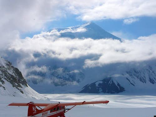 Mount Foraker from Kahiltna Base Camp with K2 plane ready for take off.