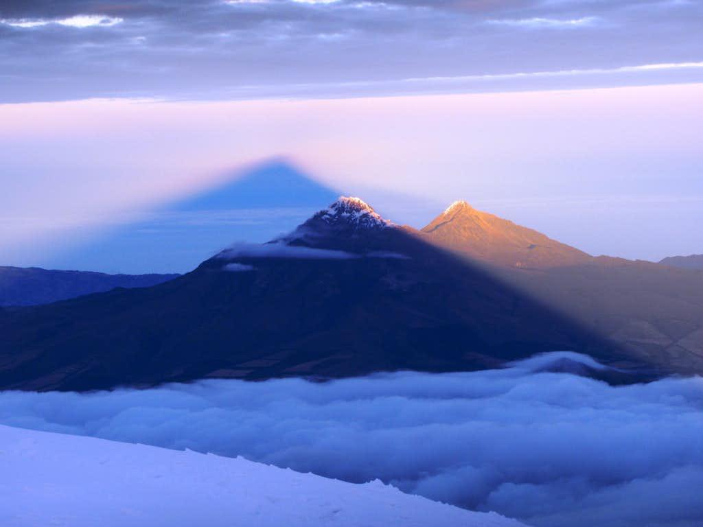 Cotopaxi's shadow over Illinizas Norte and Sur