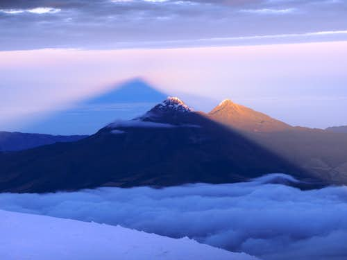 Cotopaxi\'s shadow over Illinizas Norte and Sur