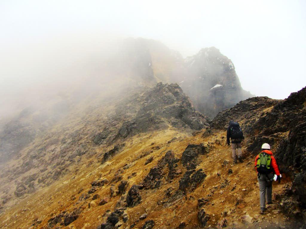 heading up the ridge on Illinizas Norte
