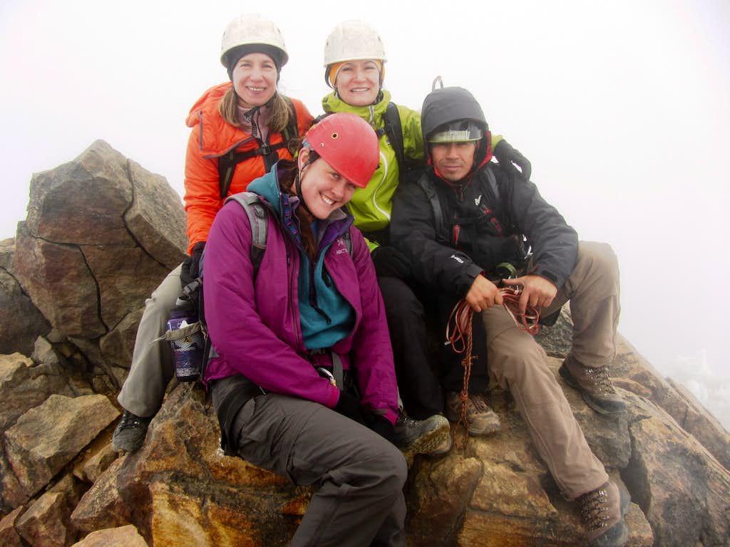 Mia, Taina, Me, and Jaime on the summit of Illinizas Norte