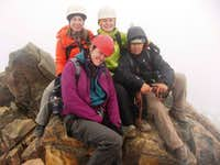 Mia, Taina, Me, and Jaime on the summit of Illinizas Norte