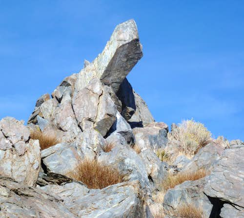 Finger-like rock below the summit