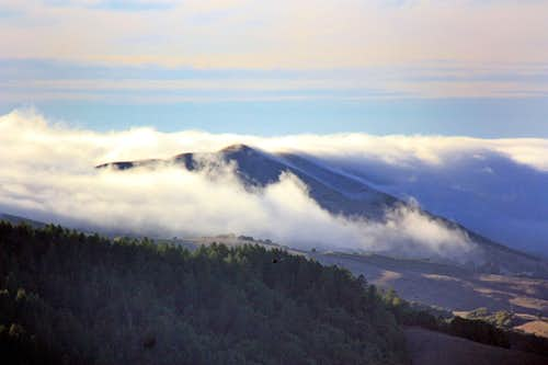 Coastal fog streams in over Black Mountain