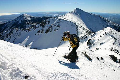 Hiking the summit ridge to...