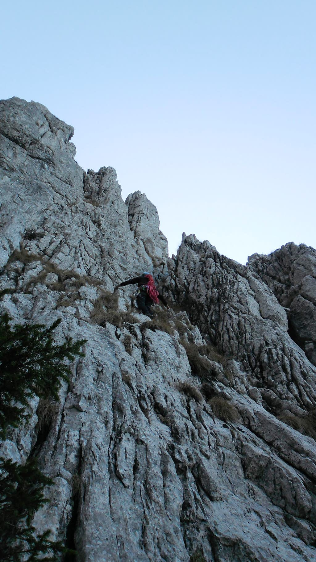 Andrei at begining of Coarnele Caprei ridge, 4A looking for the first bolt