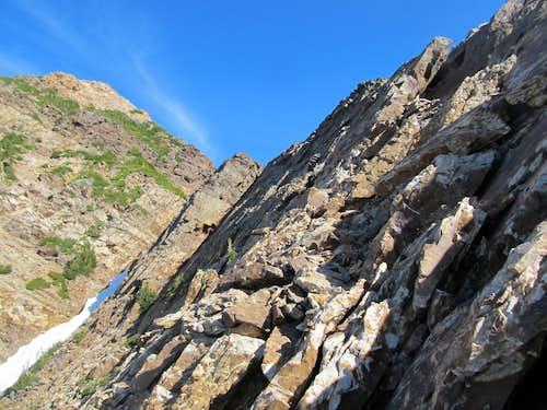 along the ledge towards route crux