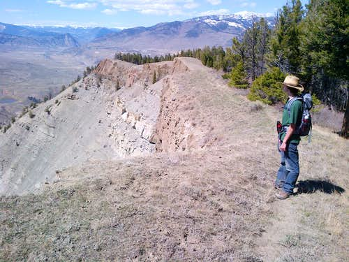 My brother above the cliff band of Mount Everts