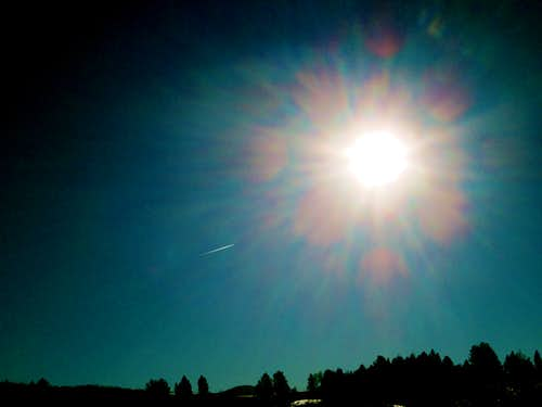 Plane flying into the sun, Blacktail Plateau, Yellowstone National Park