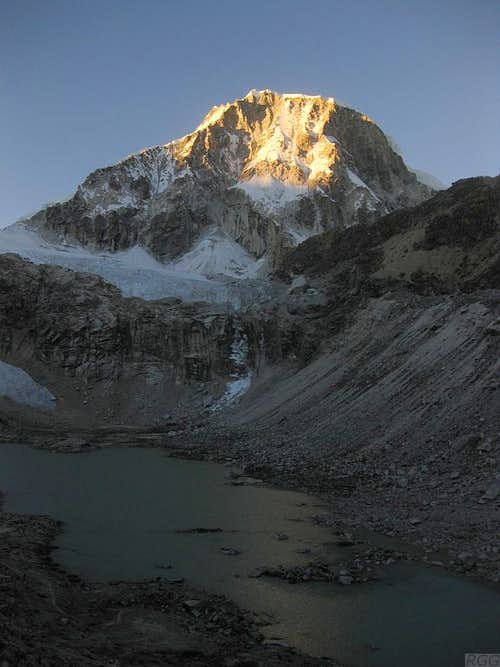 Morning light on Ranrapalca above a dark Laguna Ishinca