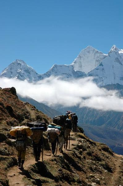 Our porters on their way to...