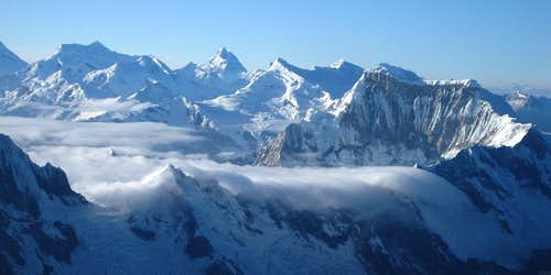 A sea of clouds streaming over the Cordillera Blanca