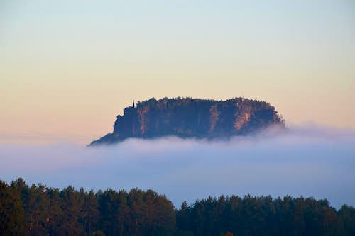 The Lilienstein looming out of the early morning fog