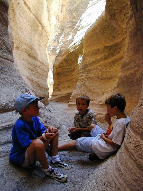 Boys playing inside the canyon