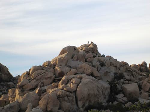 Climber on top of boulders inside the Hidden Valley Campground, Joshua Tree National ParK