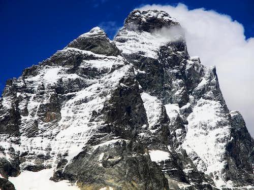 Cresta del Leone - Liongrat upper  (left skyline) after a summer snowfall