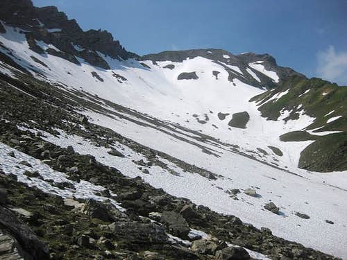 It's early summer, and a big snow field covers the northern slopes below Ijesfürggli