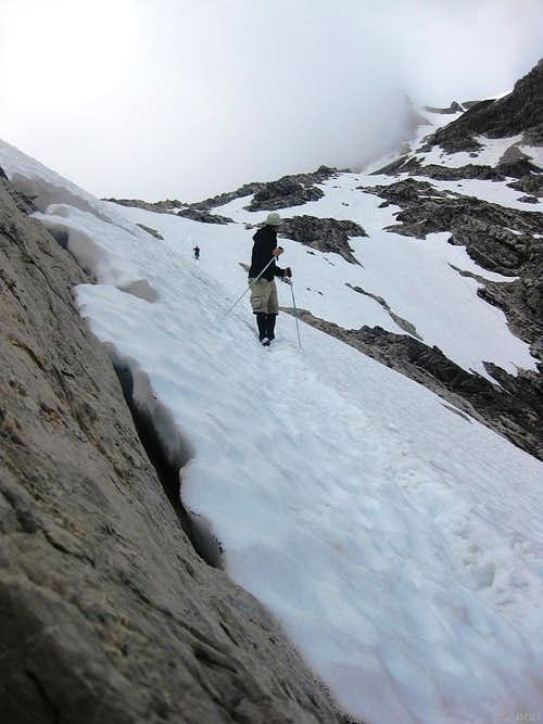 Descending a steep snow field on Schesaplana
