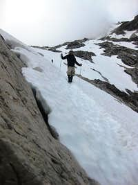 Descending a steep snow field on Schesaplana