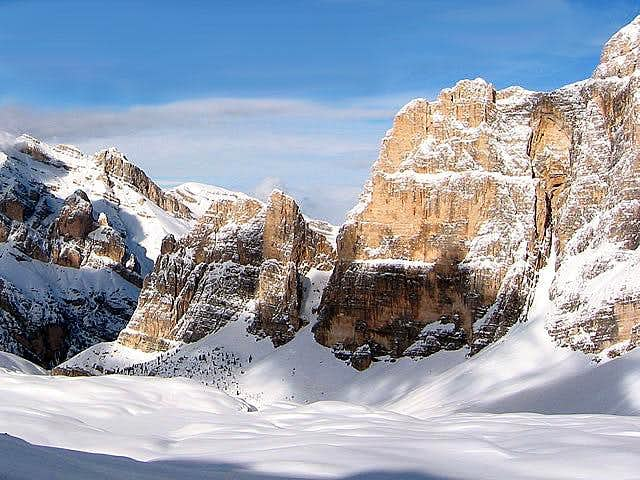 A winter image of the impressive SW wall of Cima Scotoni - Photo Gabriele