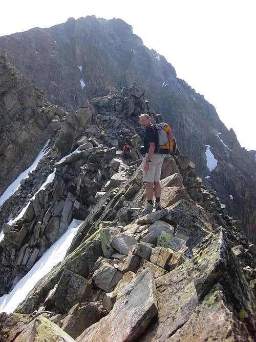 Crossing an exposed section on the Hohe Geige west ridge