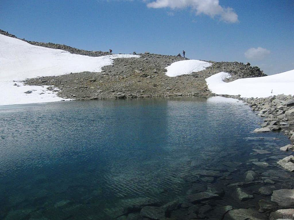 The small glacial lake southwest of the summit of Hohe Geige