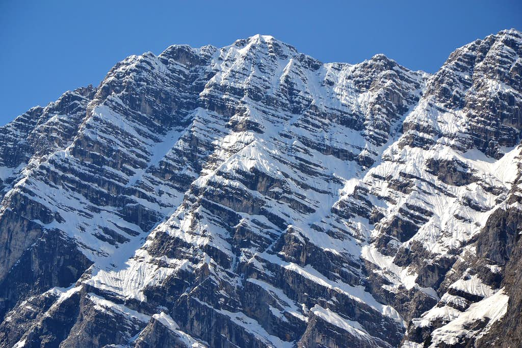 The rock bands of the Watzmann east wall covered in snow