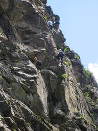 Climbers on the rocks of the Stuibenfall Via Ferrata