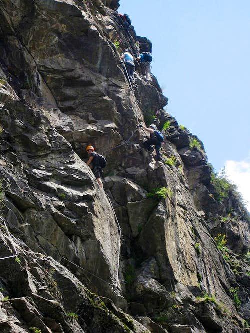 Climbers on the rocks of the Stuibenfall Via Ferrata